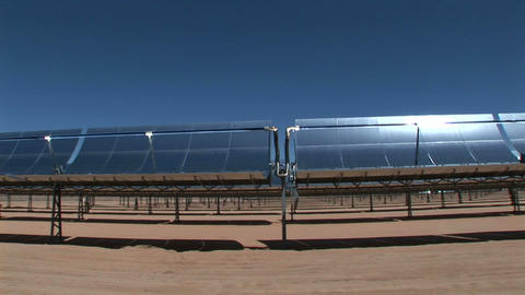 Banks of solar panels reflect in the hot sun Stock Video Footage