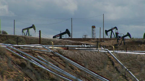 Oil pumps operate in an oil field Stock Video Footage