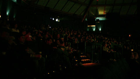 An audience watches a film in a darkened movie theater Stock Video Footage