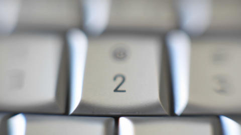 The number 2 on a computer keyboard comes into focus Footage
