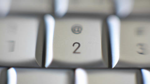 The number 2 on a computer keyboard comes into focus Stock Video Footage