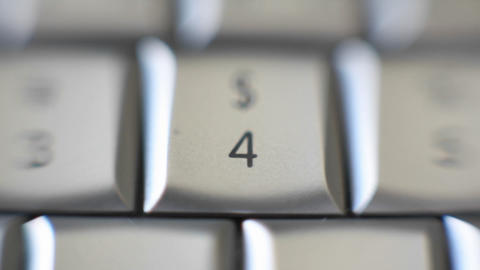 The number four on a keyboard brought into focus Stock Video Footage