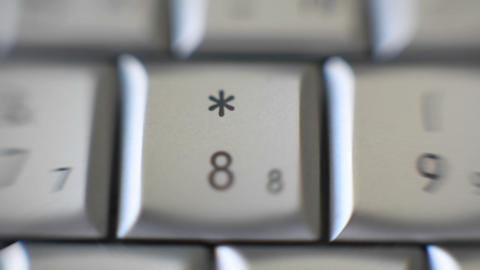 The 8 key on a keyboard quickly comes into focus Footage