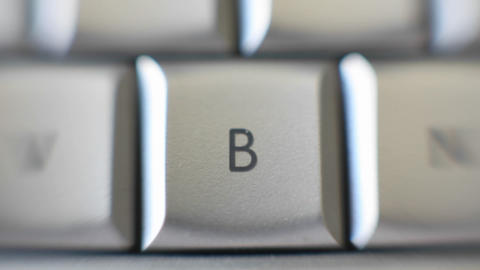 The capital letter B on a keyboard brought into focus Footage