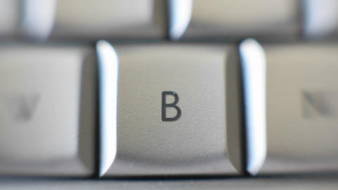 The capital letter B on a keyboard brought into focus Stock Video Footage
