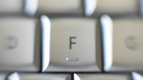 The F key of a keyboard quickly comes into focus Footage