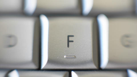 The F key of a keyboard quickly comes into focus Stock Video Footage