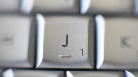Zoom on J letter on a keyboard Stock Video Footage