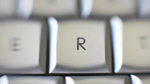 The letter R focused in on a keyboard Stock Video Footage