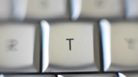 The letter T is on a computer keyboard Stock Video Footage