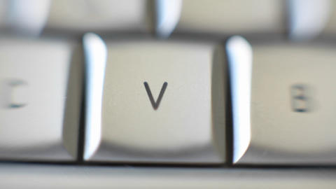 The letter V is on a computer keyboard Footage