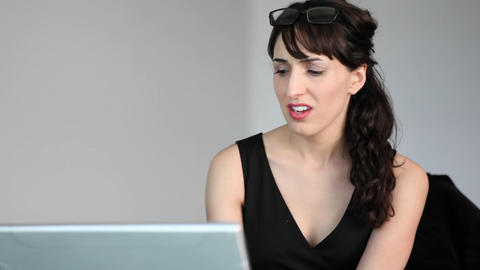 A woman displays surprise while reading online text, then... Stock Video Footage