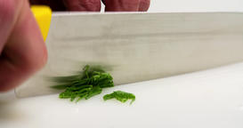Chef hand cutting with knife green herbs onion spinach 4k сlose up video Footage