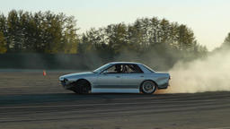 Car drifting around corner at drift racing event Footage
