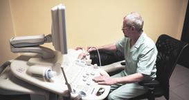 Doctor doing medical ultrasound on patient belly 4k video in diagnostic clinic Footage