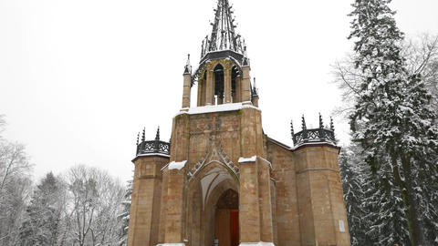 Neo gothic church of Holy Apostles Peter and Paul at winter, tilt up shot Footage