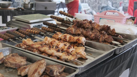 Ready-to-Eat Grilled Meat in a Street Food Shop Window. Ready-made Food on Party Live Action