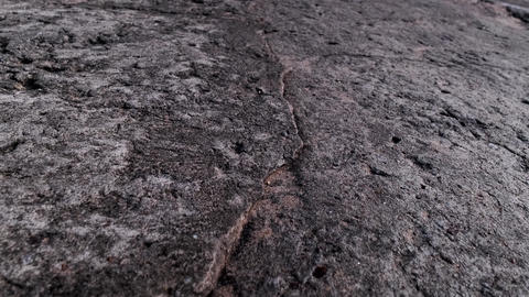 old cracked black cement stone wall. texture stone background Live Action