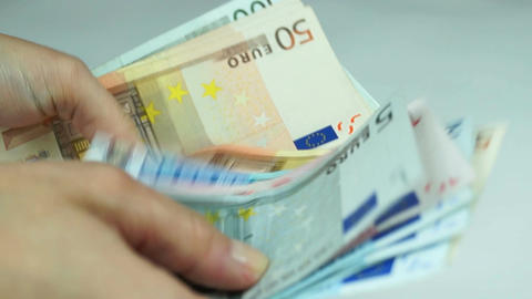 Women counts euro banknotes Footage