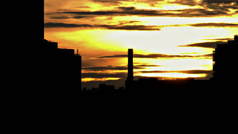 1080p Sun Sets on Background of Contrasting Shapes of Urban Buildings And Footage