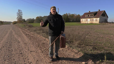 Disabled man stop the car on rural road Footage