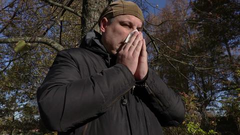 Man blowing nose Footage