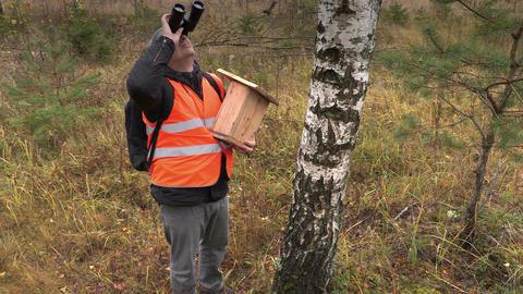 Ornithologist with binoculars watching birds Footage
