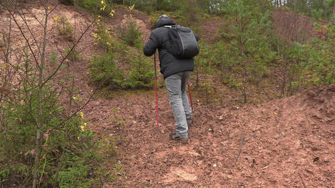 Hiker call friends and walk up to the hill Footage