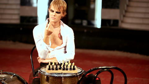 man plays chess sitting at the drum Footage