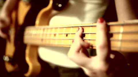 play on bass guitar. heavy grain effect added ビデオ