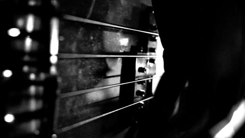 play on bass guitar. black and white ビデオ