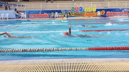 Athletes swimming competition in the pool at Pokapanitnukul school Footage