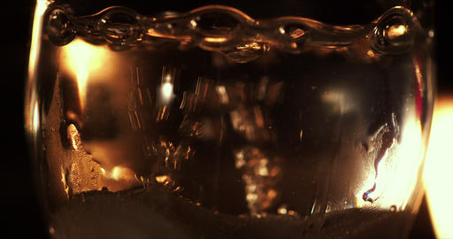 Sparkling water from bottom to top. Boiling Water Close Up with Steam. Bubbles i Live Action