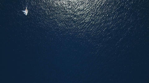 Aerial - Top down view of a sail boat sailing by Live Action
