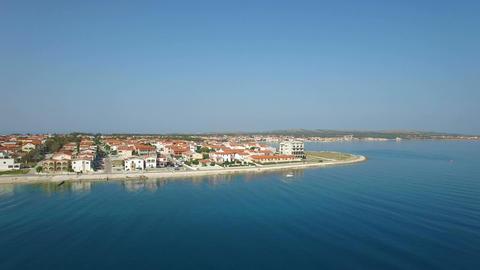 Aerial - Flying toward seaside houses on island Vir in Croatia Live Action