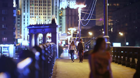 Lovers walking through the dark streets of the city Moscow Footage