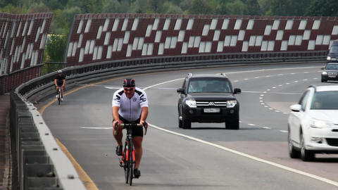 Traveling cyclists on the roads and streets of Moscow Footage