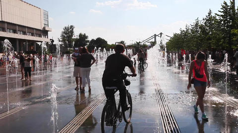 People relax in the city in celebration around the fountains and park on the str Footage