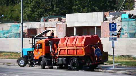 Departure watering machine and tractor streets of Moscow Footage