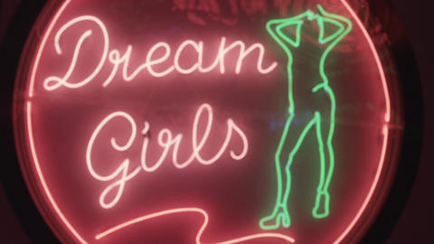 A colorful flashing and neon sing Dream Girls at night street in Maui, Thailand, Footage