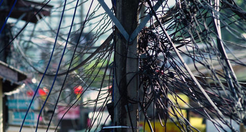 Tangled bundles of overhead wires. Electricity system on the streets of Maui, Th Footage