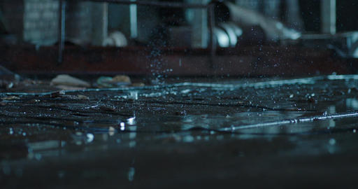 Raindrops falling into the ground. Old fabric building. Macro shot, close up, Sl Footage
