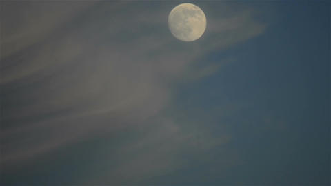 Time lapse of moving full moon and clouds Footage