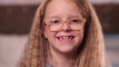Cute little girl in glasses smiling Footage