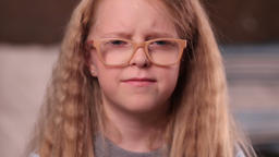 Sad little girl with confused expression Live Action