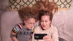 Mother and daughter making selfies on cell phone Footage