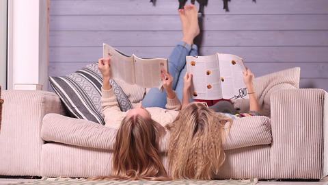Mother and daughter reading magazines together Live Action