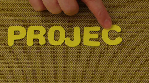 Woman hand writes the word PROJECT Footage