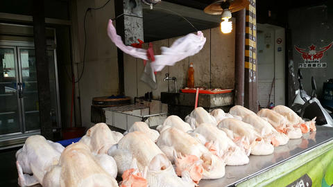 Funny way to chase away insects above raw chicken Footage