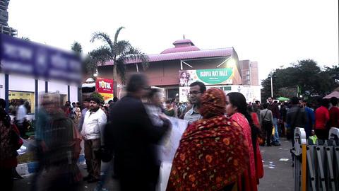 Time lapse of people walking inside book-fair at Kolkata Footage